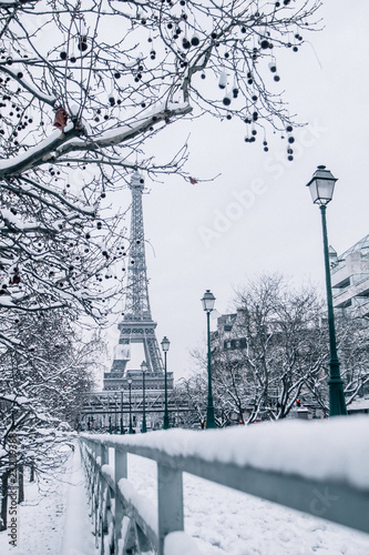 Paris in wintertime covered with snow Wallpaper Mural