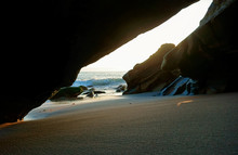 Looking At The Ocean From Inside Of A Cave Somewhere Along The California Pacific Coast.