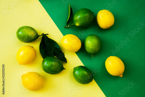 Top view of colorful yellow and green lemons on yellow green pastel background, concepts ideas of fruit, vegetable, healthy eating lifestyle