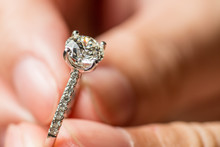 Man's Hands Holding Ring For P...