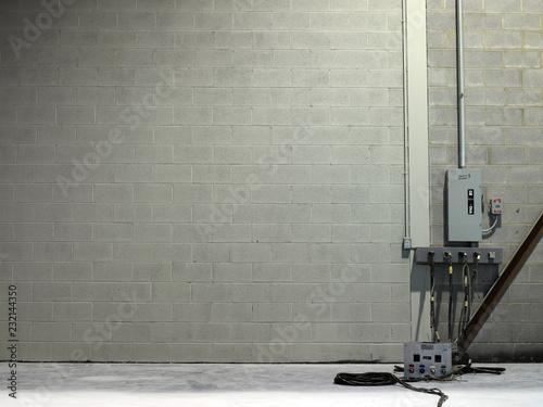 Foto op Plexiglas Baksteen muur Circuit breakers against a gray brick wall
