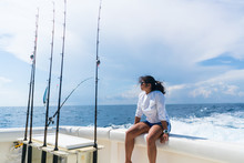 Woman Relaxing On Fishing Boat