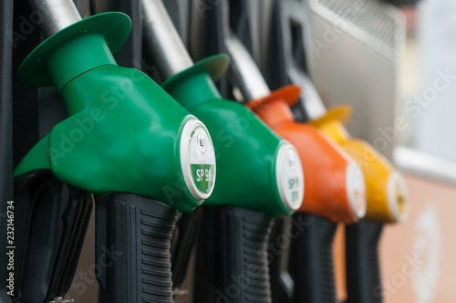 closeup of gas pistols in gas Station