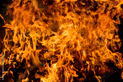 Staande foto Brandhout textuur The texture of fire on a dark background. Preparation for design_