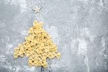 Bow Tie Pasta In Shape Of Christmas Tree On Grey Wooden Table
