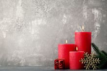 Christmas Candles With Fir-tree Branches And Snowflake On Wooden Table