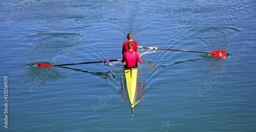 Fototapeta Two scull rowing competitor, rowing race two rower