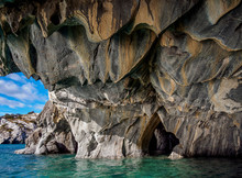 View Of Marble Caves In General Carrera Lake Against Cloudy Sky