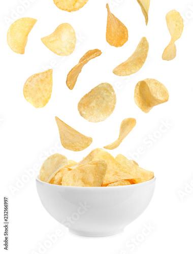 Bowl of tasty crispy potato chips on white background