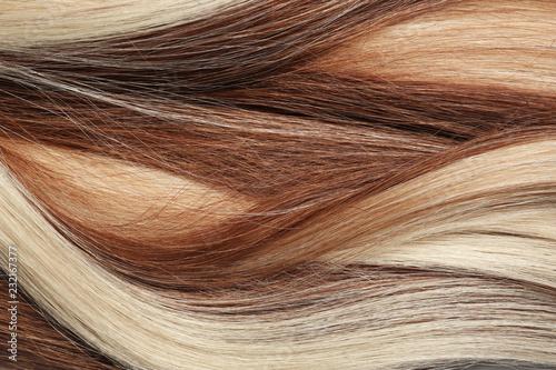 Fotografia Strands of different color hair as background, closeup