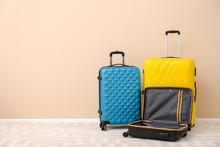 Modern Suitcases On Floor Near...