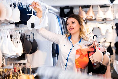 Female customer deciding on pretty bra - Buy this stock photo and ... b58397ea5