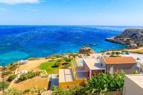 Photo Stands South Africa Colorful houses on sea coast of Karpathos island near Ammopi village, Greece