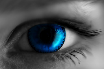 eye in blue lens, blurred at the edges