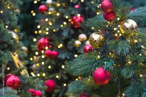 Fotografie, Obraz  fir-tree decorated with Christmas balls and ribbons, traditional New Year holida