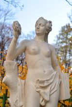 Statue Of Allegory Of Truth In Summer Garden.