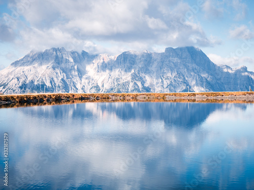 Fotobehang Bergen Image of mountain panorama with water reflections in lake
