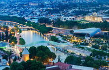 Bridge Of Peace And The Mtkvari River. On The Right, The Rike Park Music Theatre And Exhibition Hall And The Presidential Palace. Tbilisi, Georgia. Caucasus