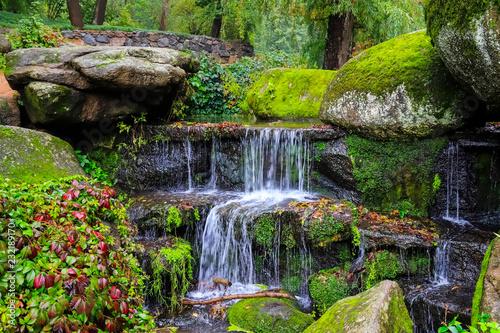 Keuken foto achterwand Watervallen A picturesque cascade waterfall among large moss covered stones in the landscape Sophia Park, Uman, Ukraine, Autumn Sofievsky
