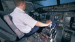 Plane flying training in a simulator, close up.