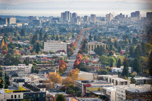 Stampa su Tela Aerial view of north Oakland on a sunny autumn evening; downtown Oakland in the