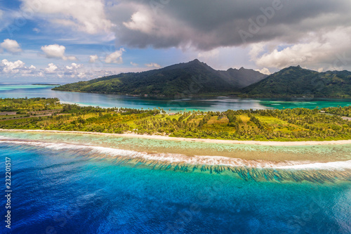 Fotobehang Oceanië Aerial French Polynesia luxury travel honeymoon destination. Beach vacation at motu island of Huahine, Tahiti, Oceania adventure. View from above of paradise, French Polynesia, South Pacific Ocean.