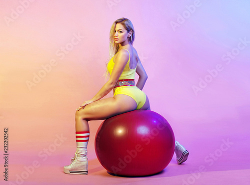 Fotografija  Attractive girl doing exercise on the gym ball.