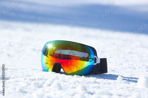Ski and snowboard mask in snow