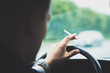 Smoking a cigarette while driving