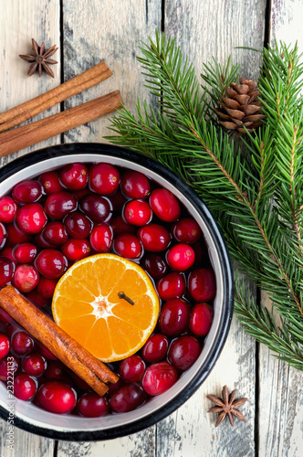 Christmas potpourri. Top view. Hot scented beverage made from cranberry, cinnamon, clementines and spices.