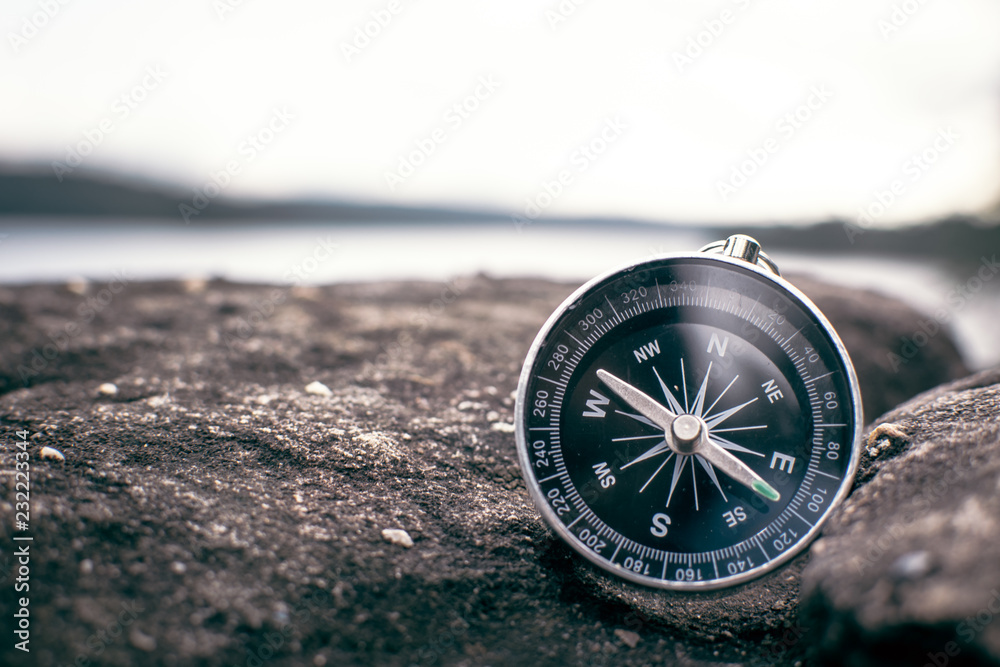 Fototapety, obrazy: compass on rock in the nature, color vintage style