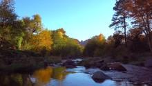 Oak Creek Canyon Near Sedona,Arizona,USA.  Fall Color Trees Catching Last Rays Of Sun, The Gentle Stream Of The Verde River.  4k Footage.