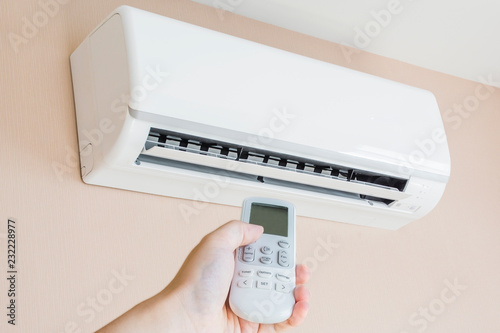 Hand controlling a remote control Canvas Print