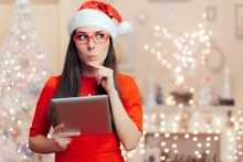 Santa Girl With PC Tablet Celebrating Christmas At Home