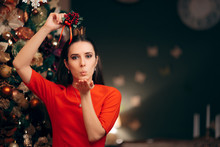 Woman Holding Mistletoe Ready For A Kiss