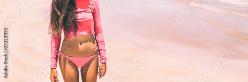 Rashguard solar protection swimwear in pink for women fashion, Bikini woman body lifestyle banner panorama.