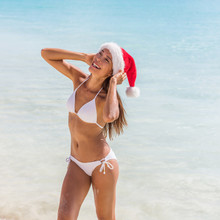 Christmas Santa Hat Bikini Body Sexy Asian Girl Happy In Sun Tan Holidays. Spa Wellness Concept Healthy Woman For Weight Loss Concept, Laser Treatment, Cellulite, Fit Body.