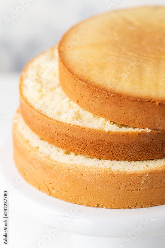 Canvas-taulu Sponge cake. Shortcakes on a white cake stand, selective focus