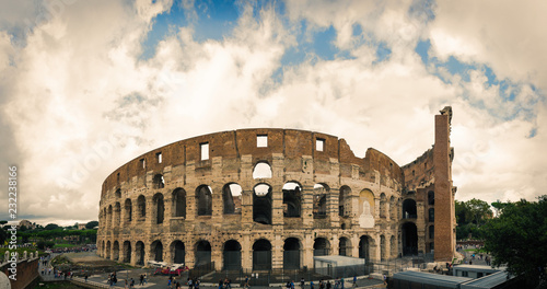 Mad clouds and Colisseum old building in Rome city, Italy Wallpaper Mural