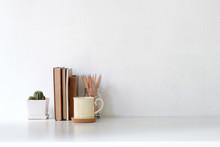 Workspace Coffee Mug, Books, Pencil And Cactus On White Desk.
