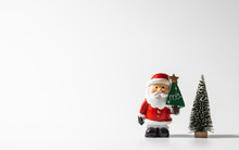 Merry Christmas And Happy New Year. Santa Claus And Christmas Tree On White Background.  Christmas Festival With Copy Space.