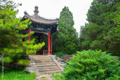 Photo Park with alcove in chinese traditional style and beautiful trees near Summer Pa