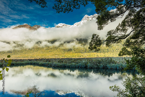 Foto op Aluminium Oceanië Mirror Lakes with reflection of Earl Mountains, Fjordland National Park, Millford, New Zealand