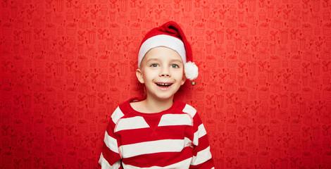 Fototapeta Lachender Junge zu Weihnachten