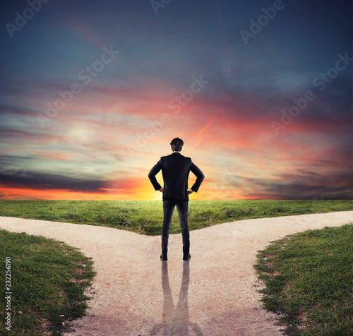 Choices of a businessman at a crossroads. Concept of decision Fotobehang