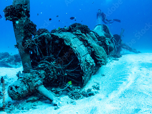 Photo Stands Shipwreck Underwater Plane Wreck from World War 2 - Scuba diving in Oahu, Hawaii