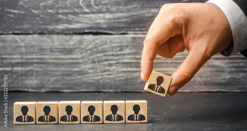 Photo  The leader builds team from cubes with employees