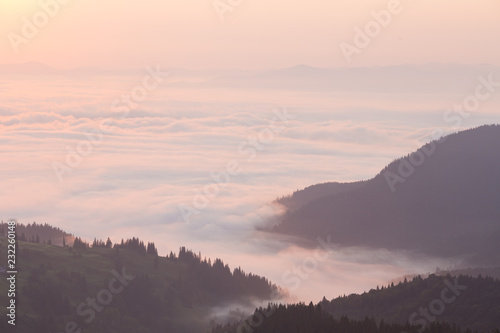 Wall Murals Cappuccino Pink clouds over mountains in the morning