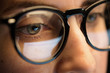 Leinwanddruck Bild - vision, business and education concept - close up of woman eyes in glasses looking at computer screen