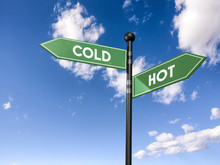 Arrow Road Signs Of Words Cold And Hot On The Blue Sky. 3D Illustration
